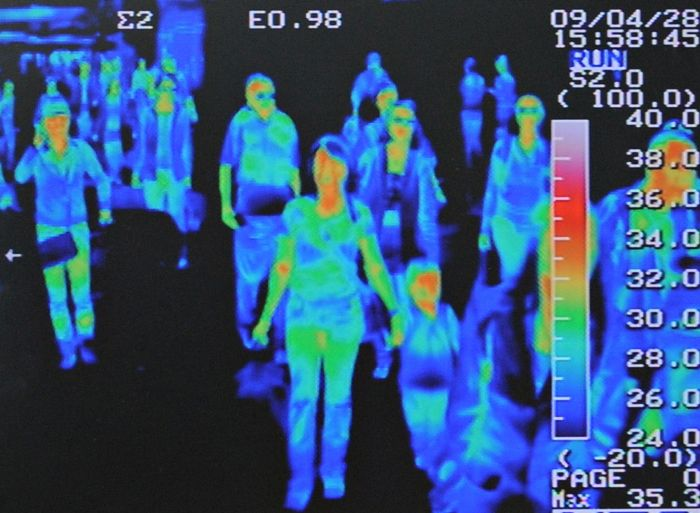 A thermal scanner shows the heat signature of passengers from an international flight arriving at Incheon airport, west of Seoul April 28, 2009. Airlines suffered an 11.1 percent fall in passenger numbers in March year-on-year, and swine flu stands to compound financial problems and suppress traffic even more, an industry body said on Tuesday. REUTERS/Jung Yeon-je (SOUTH KOREA HEALTH TRANSPORT TRAVEL)
